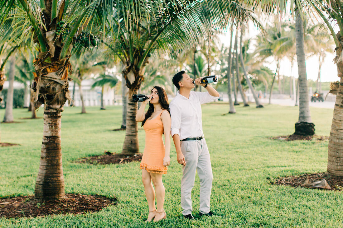 Raleigh wedding photographer Miami beach engagement champagne