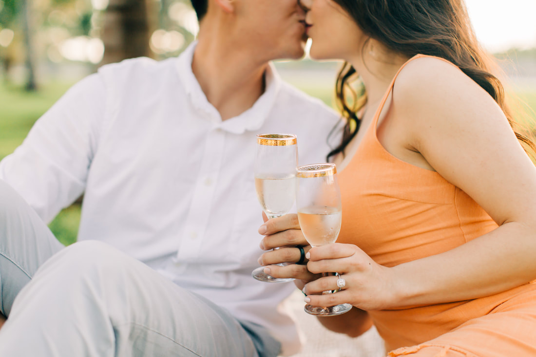Raleigh wedding photographer Miami beach engagement champagne toast